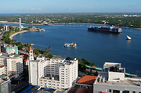 TANZANIA Daressalaam, bay and seaport, Pacific International Lines PIL container ship sailing to indian ocean, in front protestant Azania Front cathedral, built during german colonial time