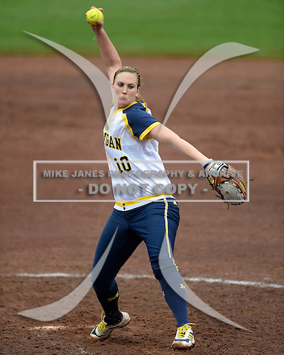 Michigan Wolverines pitcher Sara Driesenga (10) delivers a pitch during the season opener against the Florida Gators on February 8, 2014 at the USF Softball Stadium in Tampa, Florida.  Florida defeated Michigan 9-4 in extra innings.  (Copyright Mike Janes Photography)
