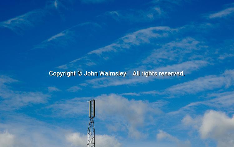 Transmitting aerial set against high cirrus clouds.