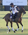 WELLINGTON, FL - JANUARY 08:  #3 Inaki LaPrida of the Grand Champions Polo Club, looks to pass the ball down field against Coca Cola, during the early rounds of the Joe Barry Memorial Cup, at the International Polo Club, Palm Beach on January 03, 2017 in Wellington, Florida. (Photo by Liz Lamont/Eclipse Sportswire/Getty Images)