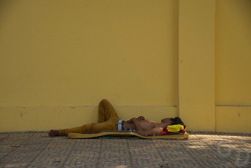 Homeless in Phnom Penh sleeping outside the Grand palace walls