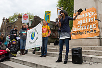 """Sheila Menon (Member of Plane Stupid).<br /> <br /> London, 29/04/2017. Today, """"Campaign Against Climate Change"""" held a demonstration started at Old Palace Yard and ended on Westminster Bridge, where people formed a human chain showing the message: """"Trump & May Climate Disaster"""". The demonstration was in support and solidarity with the People's Climate March in the US (and over 350 other marches taking place across the globe) and to warn the British Prime Minister Theresa May to stop following Donald Trump """"down the path to climate disaster"""".<br />   <br /> For more information please click here: https://www.facebook.com/events/747422225425039/ & (Video) https://www.facebook.com/campaigncc/videos/1300562783385237/ & (Press Release) http://www.campaigncc.org/node/1782"""