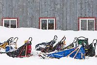 Replacement sleds await for their mushers to pick them up at McGrath during Iditarod 2009