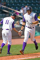 Winston-Salem Dash manager Joe McEwing #11 gives a low-five to Seth Loman #24 following his solo home run against the Wilmington Blue Rocks at the BB&T Park April25, 2010, in Winston-Salem, North Carolina.  Photo by Brian Westerholt / Four Seam Images