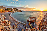 Sunrise at the famous beach Mavra Volia in Chios island, Greece
