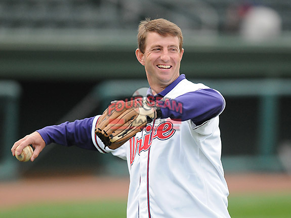 """April 13, 2009: Clemson head football coach Dabo Swinney warms up his throwing arm before Monday night's 2009 Drive opener. Swinney, who was to throw out the first pitch, said that Clemson football player C.J. Spiller had just sent him a text message, imploring him """"Don't pull your hamstring"""" when throwing the ball. Photo by: Tom Priddy/Four Seam Images"""