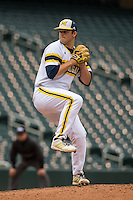 Brett Adcock (35) of the Michigan Wolverines pitches during a 2015 Big Ten Conference Tournament game between the Michigan Wolverines and Indiana Hoosiers at Target Field on May 20, 2015 in Minneapolis, Minnesota. (Brace Hemmelgarn/Four Seam Images)
