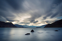 Wanaka at its best - serene, calming and beautiful, lovely lenticular cloud movement captured here by Wanaka based fine art Landscape photographer Christopher David Thompson.