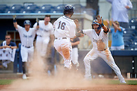 Charlotte Stone Crabs Garrett Whitley (16) and Zach Rutherford (right) celebrate after a walk-off win during a Florida State League game against the Dunedin Blue Jays on April 17, 2019 at Charlotte Sports Park in Port Charlotte, Florida.  Charlotte defeated Dunedin 4-3.  (Mike Janes/Four Seam Images)