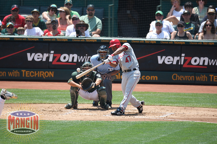 OAKLAND, CA - JULY 13:  Howie Kendrick of the Los Angeles Angels of Anaheim bats during the game against the Oakland Athletics at the McAfee Coliseum in Oakland, California on July 13, 2008.  The Angels defeated the Athletics 4-3.  Photo by Brad Mangin