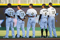 {L-R) Jared Mitchell (21), Carlos Sanchez (13), Gorkys Hernandez (9), Tyler Saladino (8) and Alex Liddi (10) stand for the National Anthem prior to the game against the Gwinnett Braves at BB&T Ballpark on April 16, 2014 in Charlotte, North Carolina.  The Braves defeated the Knights 7-2.  (Brian Westerholt/Four Seam Images)