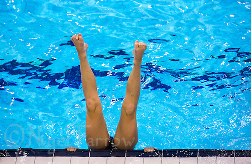 26 JUL 2012 - LONDON, GBR - A Great Britain Synchronised Swimmer warms up for a practice session at the Aquatics Centre in the Olympic Park, Stratford, London, Great Britain ahead of the start of the London 2012 Olympic Games (PHOTO (C) 2012 NIGEL FARROW)