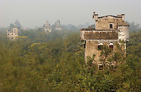 "Ma Jiang Long town near Kaiping city in Guangdong Province, China. The European style ""towers"" and mansions were built by....  overseas Chinese returning with architectural ideas from America and Europe. The area is .one of the World Heritage Site.."