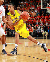 CHARLOTTESVILLE, VA- NOVEMBER 29: Trey Burke #3 of the Michigan Wolverines handles the ball during the game on November 29, 2011 at the John Paul Jones Arena in Charlottesville, Virginia. Virginia defeated Michigan 70-58. (Photo by Andrew Shurtleff/Getty Images) *** Local Caption *** Trey Burke