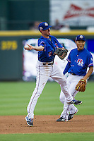 Round Rock Express shortstop Josh Wilson (2) makes a running throw to first base during the Pacific Coast League baseball game against the Sacramento River Cats on June 19, 2014 at the Dell Diamond in Round Rock, Texas. The Express defeated the River Cats 7-1. (Andrew Woolley/Four Seam Images)