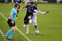 SAN JOSE, CA - NOVEMBER 4: Cristian Espinoza #10 of the San Jose Earthquakes is defended by Diego Palacios #12 of LAFC during a game between Los Angeles FC and San Jose Earthquakes at Earthquakes Stadium on November 4, 2020 in San Jose, California.
