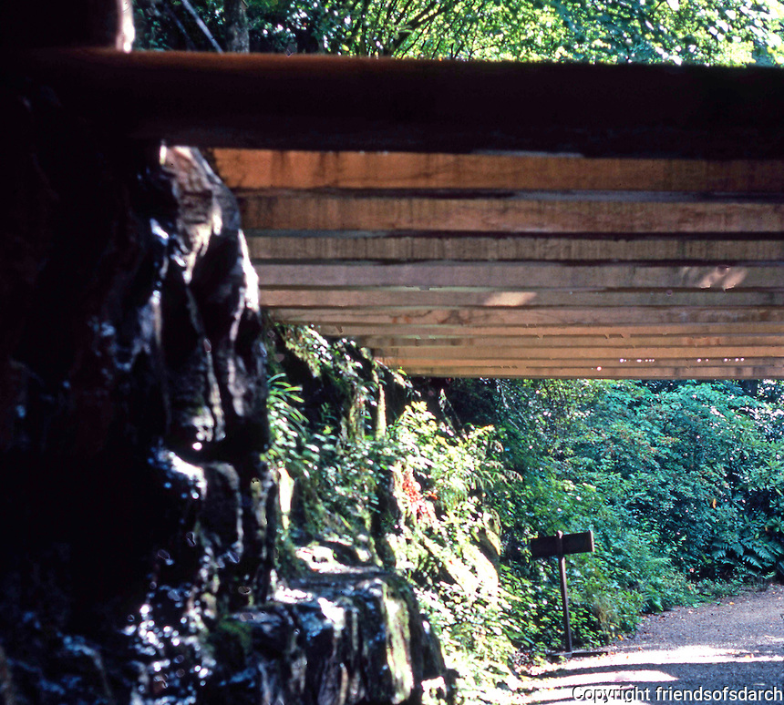 F.L. Wright: Fallingwater. Path, concrete lattice, 'round back.  Photo '76.