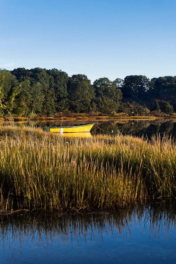 Rowboat anchored in a coastal inlet.