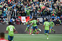 SEATTLE, WA - NOVEMBER 10: Raul Ruidiaz #9 of the Seattle Sounders FC celebrates scoring his goal with teammates Jordy Delem #21, Roman Torres #29, Kim Kee-hee #20, and Victor Rodriguez #8 during a game between Toronto FC and Seattle Sounders FC at CenturyLink Field on November 10, 2019 in Seattle, Washington.