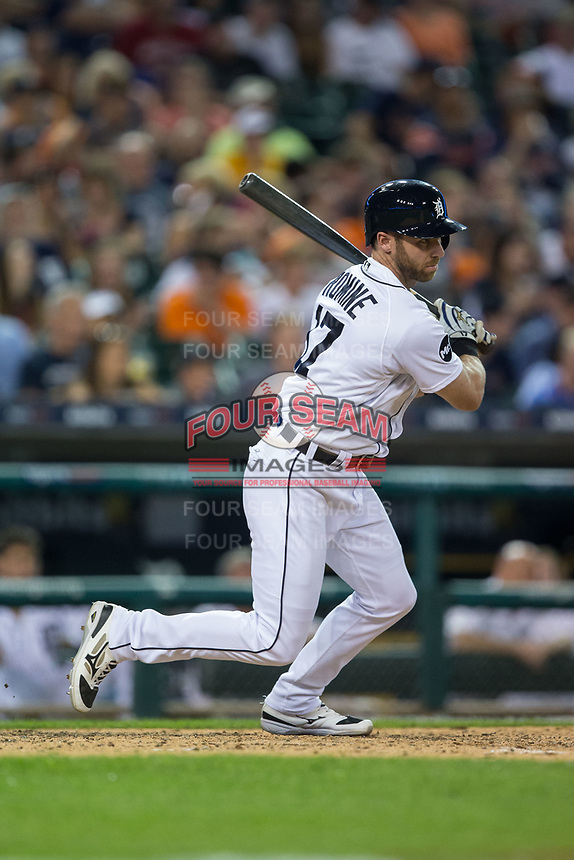 Andrew Romine (17) of the Detroit Tigers follows through on his swing against the Chicago White Sox at Comerica Park on June 2, 2017 in Detroit, Michigan.  The Tigers defeated the White Sox 15-5.  (Brian Westerholt/Four Seam Images)
