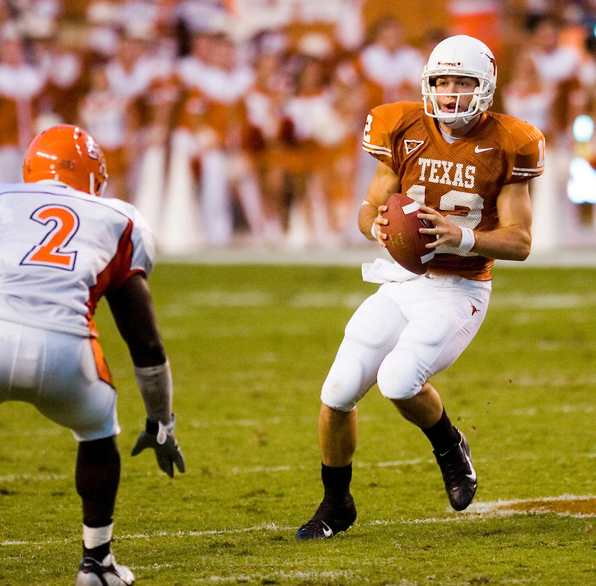 30 September 2006: Texas quarterback Colt McCoy (#12) looks to dodge Sam Houston State defender Byran Richmond (#2) during the Longhorns 56-3 victory over the Sam Houston State Bearkats at Darrell K Royal Memorial Stadium in Austin, TX.