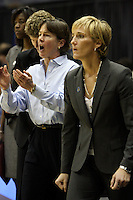 BERKELEY, CA - MARCH 30: Head coach Tara Vanderveer and assistant coach Kate Paye directing traffic during Stanford's 84-66 win against the Ohio State Buckeyes on March 28, 2009 at Haas Pavilion in Berkeley, California.