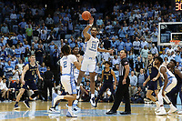 CHAPEL HILL, NC - NOVEMBER 06: Garrison Brooks #15 of the University of North Carolina wins the opening tip-off during a game between Notre Dame and North Carolina at Dean E. Smith Center on November 06, 2019 in Chapel Hill, North Carolina.