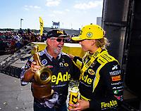 May 6, 2018; Commerce, GA, USA; NHRA top fuel driver Leah Pritchett (right) celebrates with sponsor Ron Thames after winning the Southern Nationals at Atlanta Dragway. Mandatory Credit: Mark J. Rebilas-USA TODAY Sports