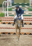 19 April 2009: Darragh Kerins  (IRL) and Night Train at the Rolex FEI World Cup Final III, first round.