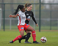 Zulte Waregem's forward Esther Buabadi (L)  and Woluwe's Stephanie Suenens (R)  pictured during a female soccer game between SV Zulte - Waregem and White Star Woluwe on the 9th matchday of the 2020 - 2021 season of Belgian Scooore Women s SuperLeague , saturday 12 th of December 2020  in Waregem , Belgium . PHOTO SPORTPIX.BE | SPP | DIRK VUYLSTEKE