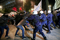 Pictured: Protest clash with riot police on the first day of visit by  German Chancellor Angela Merkel in central Athens, Greece.<br /> Re: Official visit of German Chancellor Angela Merkel  to Athens, Greece.