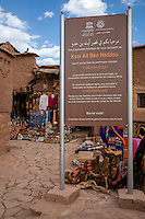Morocco.  Sign Welcoming Visitors to Ait Ben Haddou Ksar, a World Heritage Site.