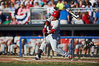 Auburn Doubledays left fielder Oliver Ortiz (9) hits a sacrifice fly ball during a game against the Batavia Muckdogs on July 4, 2017 at Dwyer Stadium in Batavia, New York.  Batavia defeated Auburn 3-2.  (Mike Janes/Four Seam Images)