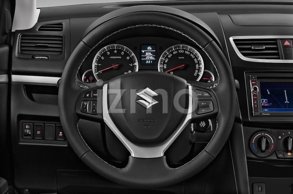 Car pictures of steering wheel view of a 2013 Suzuki SWIFT Grand Luxe @ttraction 5 Door Hatchback 2WD Steering Wheel