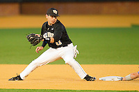 Shortstop Pat Blair #11 of the Wake Forest Demon Deacons looks to apply a tag on a Western Carolina Catamounts runner at Gene Hooks Field on February 22, 2011 in Winston-Salem, North Carolina.  Photo by Brian Westerholt / Four Seam Images