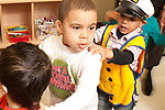 Education Preschool row of boys walking with hands on each other's shoulders in a line one wearing dressup outfit pretend play game