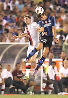 Jonathan Blablany #50 of Inter Milan goes for a header against Adam Johnson #11  of Manchester City during an international friendly match on July 31 2010 at M&T Bank Stadium in Baltimore, Maryland. Milan won 3-0.