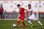 Nguyen Cong Phuong of Vietnam (L) competes for the ball with Omid Ebrahimi Zarandini of Iran during the AFC Asian Cup UAE 2019 Group D match between Vietnam (VIE) and I.R. Iran (IRN) at Al Nahyan Stadium on 12 January 2019 in Abu Dhabi, United Arab Emirates. Photo by Marcio Rodrigo Machado / Power Sport Images
