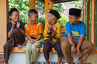 Borobudur, Java, Indonesia.  Young Boys waiting for Friday Noon Prayers at Neighborhood Mosque.
