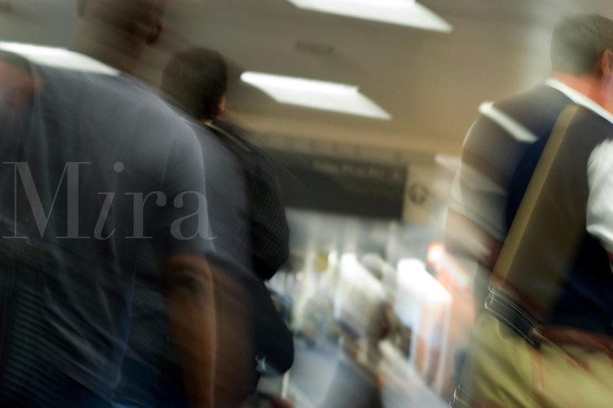 Travelers passing through a concourse in Atlanta's Hartsfield-Jackson International Airport.
