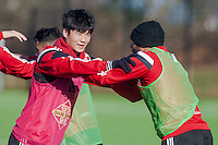 SWANSEA, WALES - FEBRUARY 17: Ki Sung-Yueng of Swansea City    in action during a training session at the Fairwood training ground on February 17, 2015 in Swansea, Wales.  (Photo by Athena Pictures )