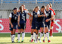 US's Alex Morgan celebrates his goal against Germany with teammates during their Algarve Women's Cup soccer match at Algarve stadium in Faro, March 13, 2013.  .Paulo Cordeiro/ISI