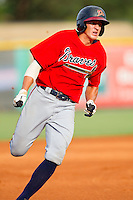 Nick Ahmed #22 of the Danville Braves hustles towards third base against the Burlington Royals at Burlington Athletic Park on August 14, 2011 in Burlington, North Carolina.  The Braves defeated the Royals 10-2 in a game called by rain in the bottom of the 8th inning.   (Brian Westerholt / Four Seam Images)