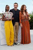 """CANNES, FRANCE - JULY 17: Fatou N'Diaye, Jean Dujardin and Natacha Lindinger at photocall for the film """"OSS 117 : Alerte Rouge en Afrique Noire"""" (OSS 117 : From Africa With Love) at the 74th annual Cannes Film Festival in Cannes, France on July 17, 2021 <br /> CAP/GOL<br /> ©GOL/Capital Pictures"""