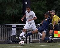 Boston College forward Charlie Rugg (17) crosses the ball as Quinnipiac University defender Brandon Strain-Goode (2) defends. Boston College defeated Quinnipiac, 5-0, at Newton Soccer Field, September 1, 2011.