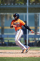 Baltimore Orioles first baseman Aderlin Rodriguez (60) follows through on a swing during a minor league Spring Training game against the Boston Red Sox on March 16, 2017 at the Buck O'Neil Baseball Complex in Sarasota, Florida.  (Mike Janes/Four Seam Images)