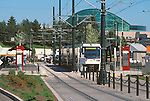 Trimet's MAX light rail car at Rose Quarter with the Oregon Convention Center in the background.
