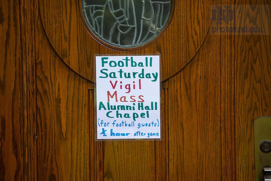 Aug. 30, 2014; Sign for vigil Mass outside Alumni Hall chapel..Photo by Matt Cashore/University of Notre Dame