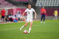 KASHIMA, JAPAN - JULY 27: Kelley O'Hara #5 of the United States passes off the ball before a game between Australia and USWNT at Ibaraki Kashima Stadium on July 27, 2021 in Kashima, Japan.