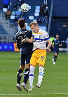 KANSAS CITY, KS - NOVEMBER 22: Jaylin Lindsey #26 of Sporting KC and Jackson Yueill #14 of the San Jose Earthquakes battle for a header before a game between San Jose Earthquakes and Sporting Kansas City at Children's Mercy Park on November 22, 2020 in Kansas City, Kansas.
